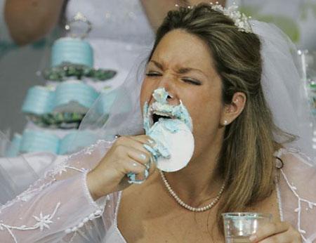 bride wolfing cake