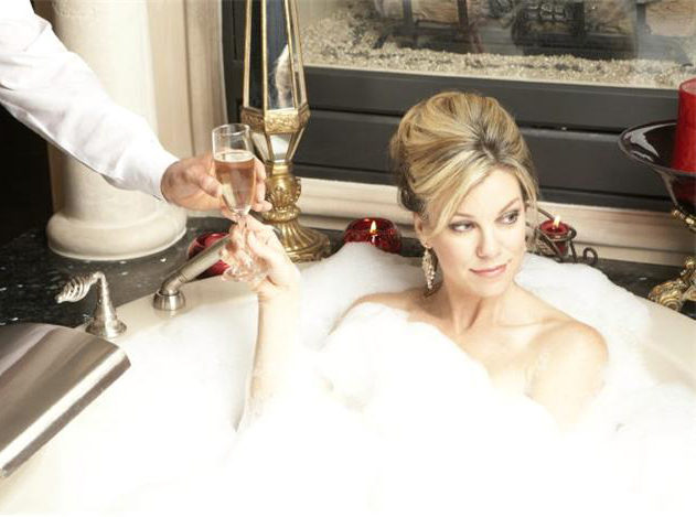 Wealthy Woman Served Champagne in Bubble Bath
